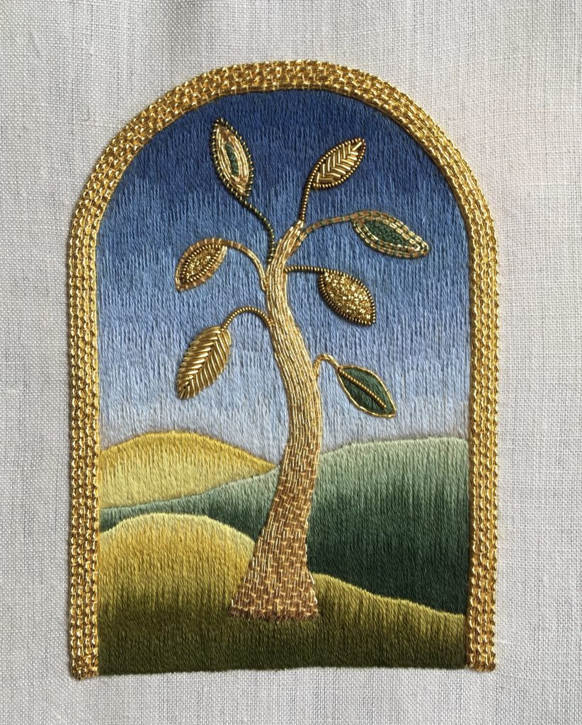 Goldwork tree with tapestry shaded background and couched goldwork border.