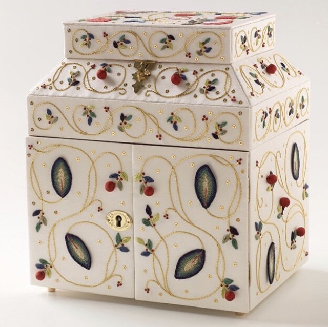 Stumpwork casket in cream silk, embroidered with leaves, berries and goldwork tendrils.