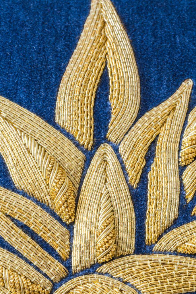 Goldwork embroidered pineapple on blue Velvet