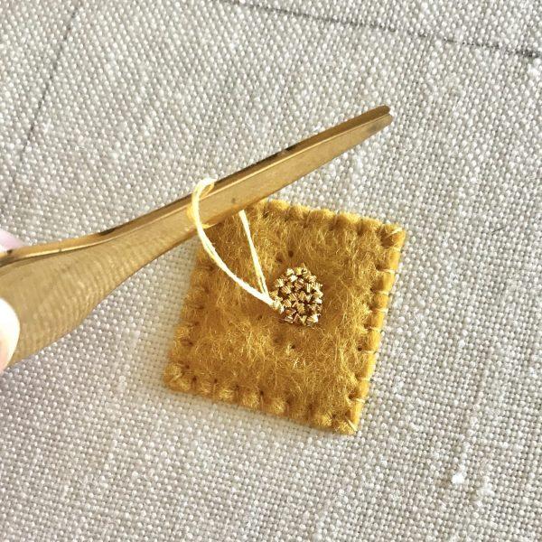 Chipping on felt padding, goldwork