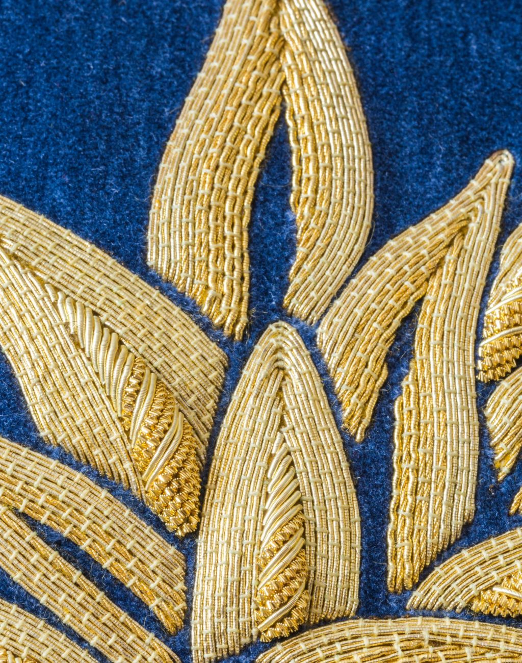 Goldwork embroidered pineapple on blue Velvet